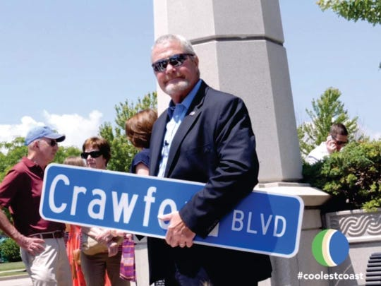 Kevin Crawford, Manitowoc's 26th mayor, had a portion of Dewey Street in the Harbor Town District named after him as Crawford Boulevard June 29.
