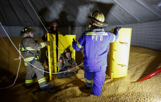 Firefighters take part in a grain bin rescue training exercise on October 28, 2019, in Pittsville, Wis. Seven different agencies took part in the exercise.Tork Mason/USA TODAY NETWORK-Wisconsin