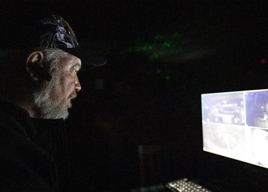 Ghost hunter Dave Oliver runs electronics during a search for the ghost of Muriel Wilkins at the Hollywood Cafe outside Tunica on Saturday, Oct. 26, 2019.