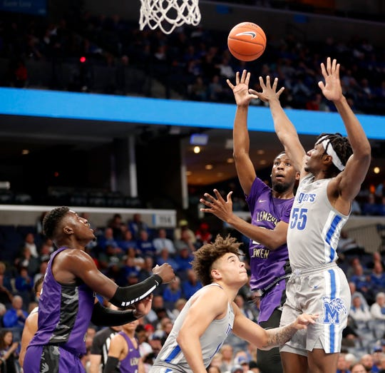 LeMoyne-Owen's Jalen Jackson (23) takes a shot past Memphis' Precious Achiuwa (55) on Monday, Oct. 28, 2019, during an exhibition game at FedEx Forum in downtown Memphis. Memphis won 88-63.