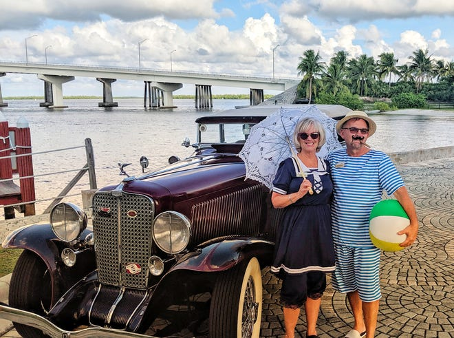 Kathy and David Caruso, in their 1920s Atlantic City swim wear, pose with a vintage Auburn car that was part of the decorations for the Yacht Club'sRoaring '20s Welcome Back event.