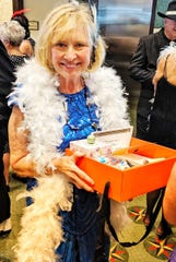 Cigarette Girl Joan Gorman with her basket of candy cigarettes, cigars and gift items from the Yacht Club Ships store.