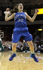 Stephanie Kostowicz was an all-state basketball player for the state-champion Oak Creek Knights in 2014 and was a star athlete on the track and field team.