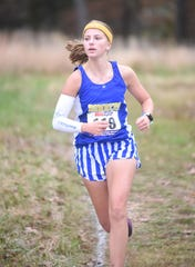 Mountain Home's Marcie Cudworth leads the field during the 5A-East Conference meet on Monday.