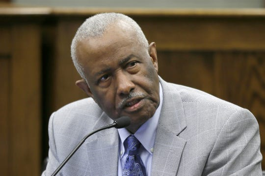 In this March 25, 2015 file photo, Rep. John Walker, D-Little Rock, speaks at the Arkansas state Capitol in Little Rock, Ark. Walker, an Arkansas lawmaker and civil rights attorney who represented black students in a long-running court fight over the desegregation of Little Rock area schools, died Monday. He was 82.