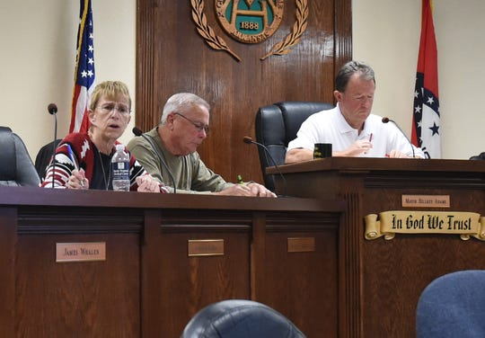 Mountain Home council member Jennifer Baker (left) talks about the city's millage rate as council member Wayne Almond (center) and Mayor Hillrey Adams (right) listen on Monday night.. The Council ultimately decided to leave the city's millage rate the same it has been for the past two decades.
