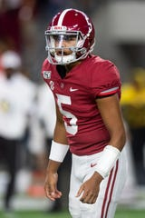 Alabama quarterback Taulia Tagovailoa (5) faces off against Arkansas at Bryant-Denny Stadium in Tuscaloosa, Ala., on Oct. 26, 2019.