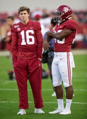 Injured Alabama placekicker Will Reichard (16) talks with kicker Ty Perine (99) at Bryant-Denny Stadium in Tuscaloosa, Ala., on Saturday October 26, 2019.