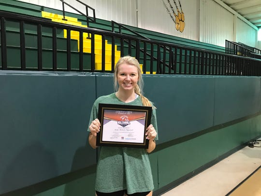 Edgewood Academy's Katie Roberst poses with her player of the week award.