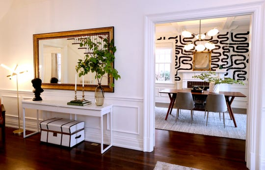 """The entrance hall and dining room of the home of Lacey and Kirk Garrett. The Garrett home will be featured during Main Street's annual autumn fundraiser, """"An Evening on University."""""""