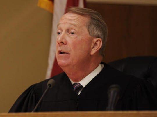John Wootten Jr., a 15th Judicial District Circuit Court judge since 1998, is retiring.