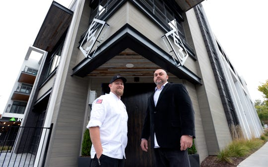 Executive chef Eric Zizka and general manager Steve Perdue stand in front of E3 Chophouse, the Colorado-based steakhouse owned by Luke Bryan, Jason Alden and former major league baseball player Adam LaRoche, on Tuesday, Oct. 22, 2019, in Nashville.