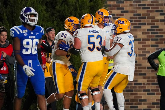 Oct 5, 2019; Durham, NC, USA;  Pittsburgh Panthers tight end Nakia Griffin-Stewart (86) is congratulated by  offensive lineman Jake Kradel (53) offensive lineman Rashad Wheeler (37) and quarterback Kenny Pickett (8) after his second half touchdown catch against the Duke Blue Devils at Wallace Wade Stadium. The Pittsburgh Panthers defeated the Duke Blue Devils 33-30. Mandatory Credit: James Guillory-USA TODAY Sports
