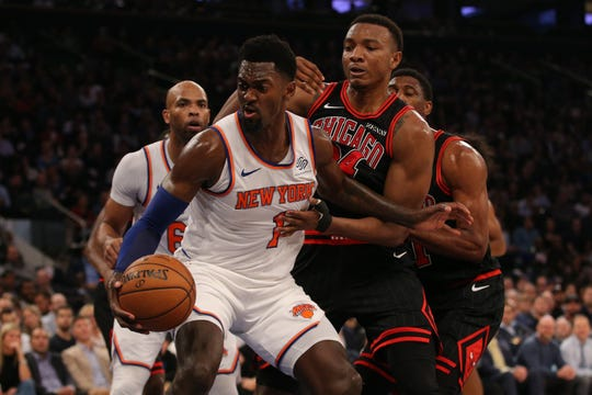 Oct 28, 2019; New York, NY, USA; New York Knicks power forward Bobby Portis (1) controls the ball against Chicago Bulls center Wendell Carter Jr. (34) during the second quarter at Madison Square Garden. Mandatory Credit: Brad Penner-USA TODAY Sports