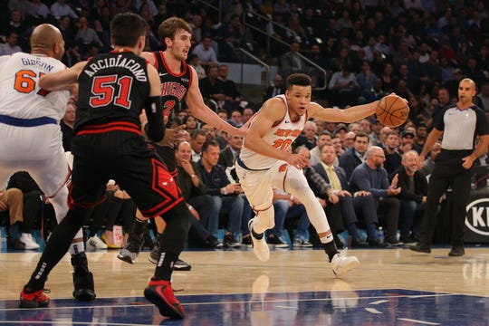 Oct 28, 2019; New York, NY, USA; New York Knicks small forward Kevin Knox II (20) drives around Chicago Bulls power forward Luke Kornet (2) during the first quarter at Madison Square Garden. Mandatory Credit: Brad Penner-USA TODAY Sports
