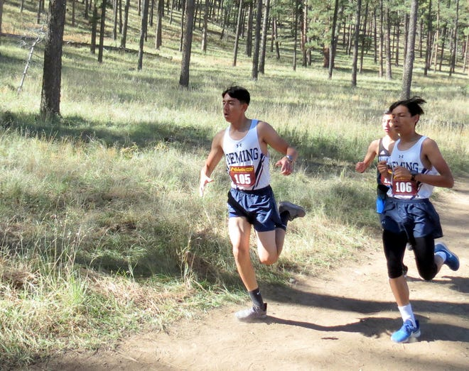 Pictured from left, sophomores Daniel Aguilar and Esau Au pace themselves on the hilly trails of Ruidoso, NM.