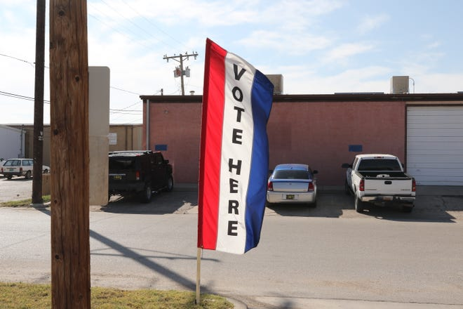 A banner waves in the wind Tuesday indicating where Eddy County residents can vote early before the Nov. 5 Local Election.
