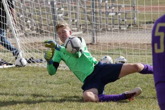 Kirtland Central goalkeeper Ethan Pierro drops down and makes a save with his left arm during Tuesday's practice at KCHS.