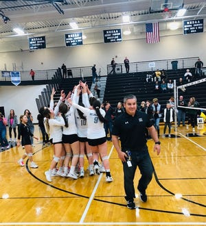 South Lyon East volleyball celebrates after securing the conference title. The South Lyon East volleyball team won its first Lakes Valley Conference title.