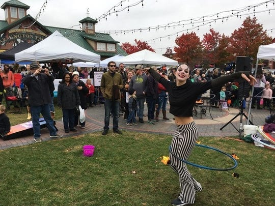 Street performers added an air of magic to the last day of the farmers market.