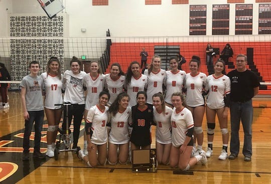 Northville celebrates winning the KLAA tournament.