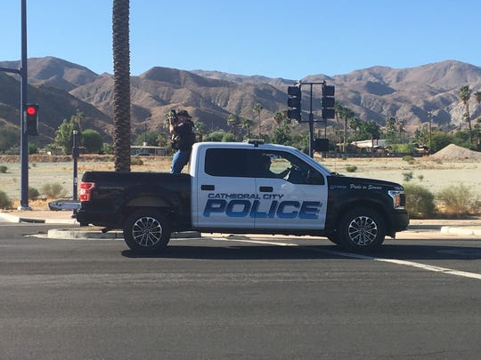 A Cathedral City police investigator takes photos of a collision scene involving a bicyclist on East Palm Canyon Drive Tuesday, Oct. 29, 2019.