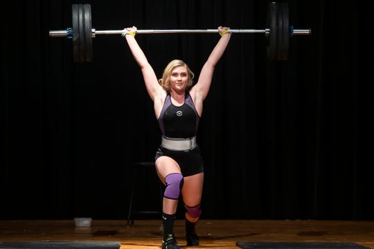 New Oxford's Mackenzie Christie demonstrates the sport of Olympic weightlifting during the talent competition at the 51st Miss Hanover Area Pageant on Monday, Oct. 28, 2019.