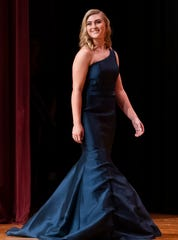 New Oxford's Mackenzie Christie walks on stage during the evening gown competition at the 51st Miss Hanover Area Pageant on Monday, Oct. 28, 2019.