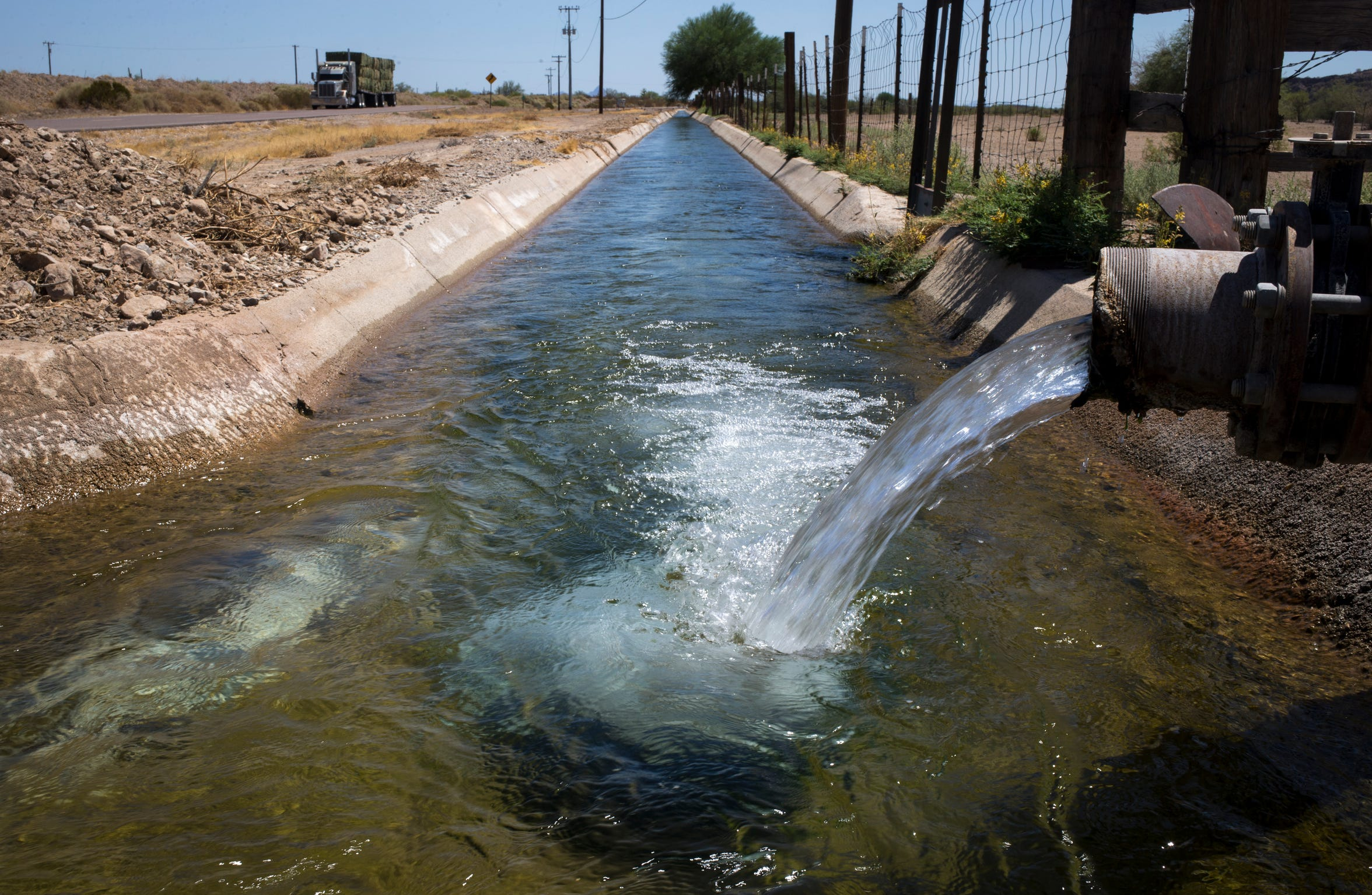 Groundwater pumped from a wells flows into an irrigation canal south of Salome, Arizona.