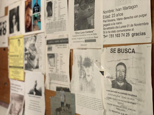 Dozens of posters of missing persons hang at the entrance to the public ministry in Puerto Peñasco, where state lab workers are collecting DNA samples of family members with missing relatives on Oct. 29, 2019.