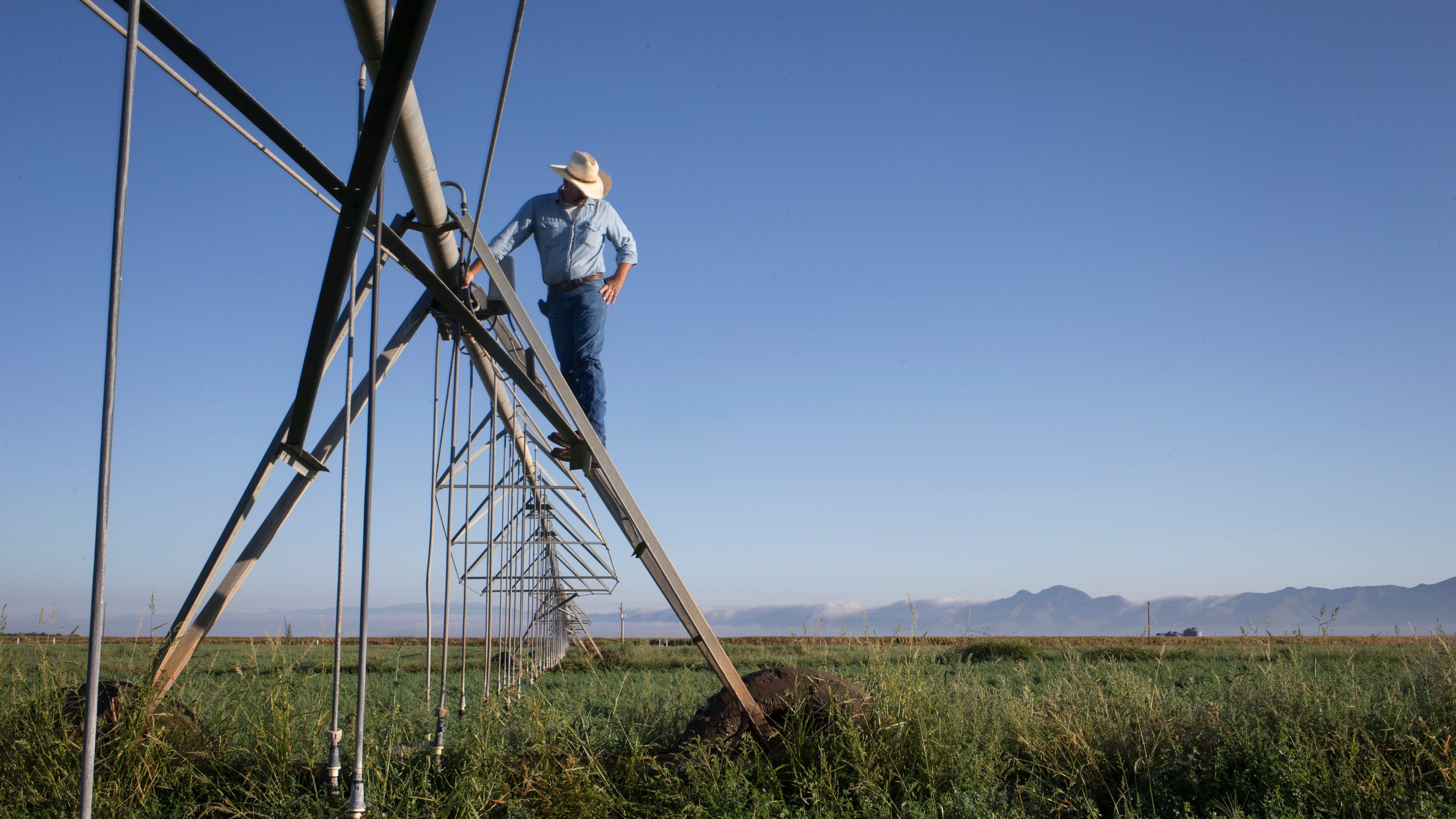 In southeastern Arizona, farms drill a half-mile deep while families pay the price