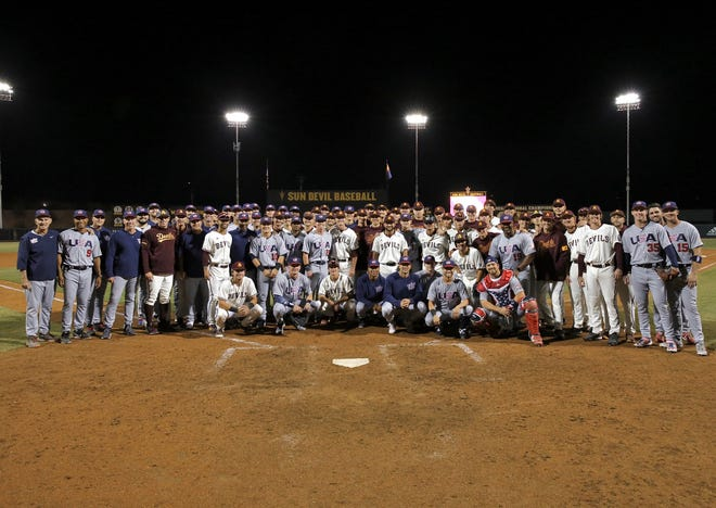 Members of Team USA pose for a photograph with the ASU baseball team after an exhibition.
