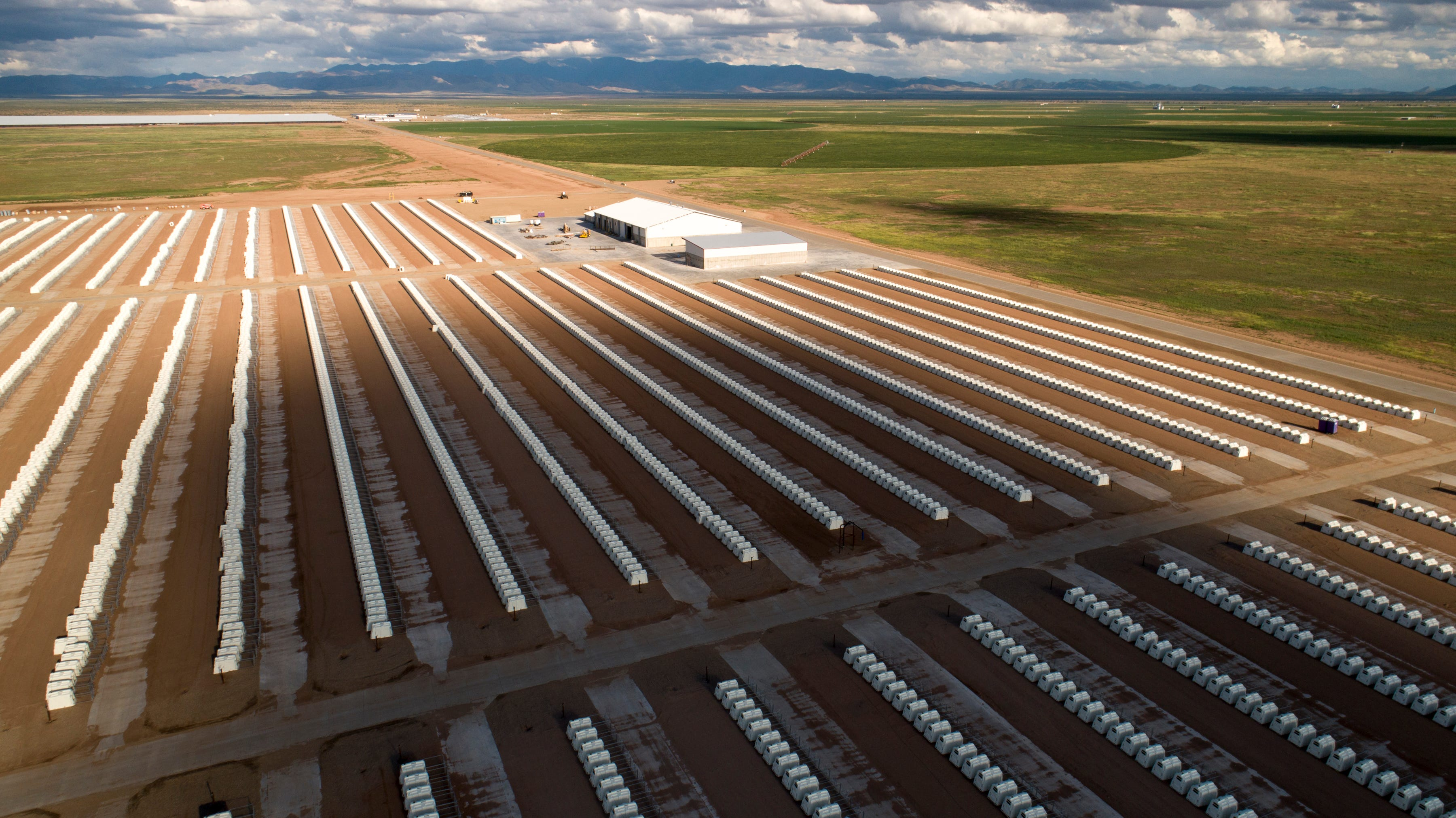 """Thousands of plastic shelters for calves, called """"calf huts,"""" spread out in rows at the new Turkey Creek Dairy. Riverview grows crops to feed the cattle at its dairies near Willcox, using groundwater to irrigate fields."""