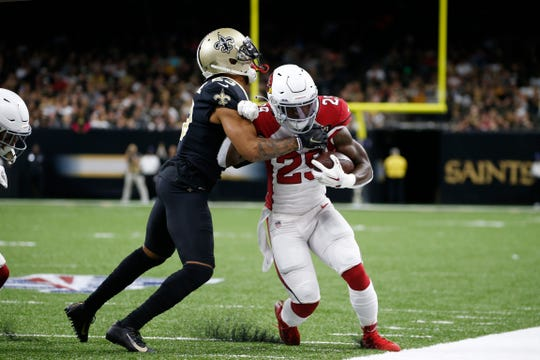 Arizona Cardinals running back Chase Edmonds (29) carries against New Orleans Saints cornerback Marshon Lattimore (23) in the first half of an NFL football game in New Orleans, Sunday, Oct. 27, 2019.