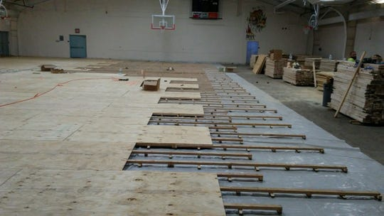 Globe is still installing its new gymnasium floor.