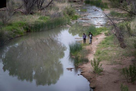 Desiree Velarde (left) and Jesse Arvayo walk along the San Pedro River near Charleston Road, northeast of Sierra Vista.