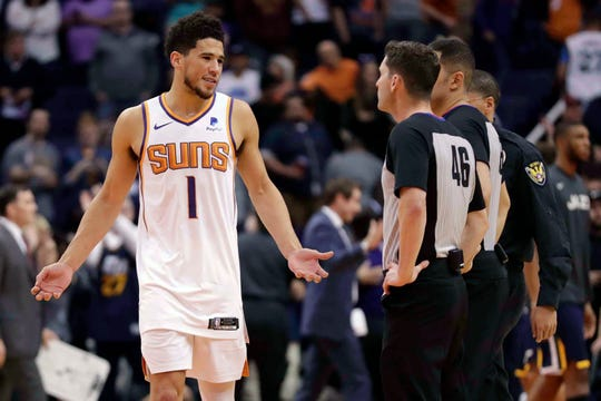 Devin Booker looks at the officials after a game against the Jazz on Oct. 28 at Talking Stick Resort Arena.