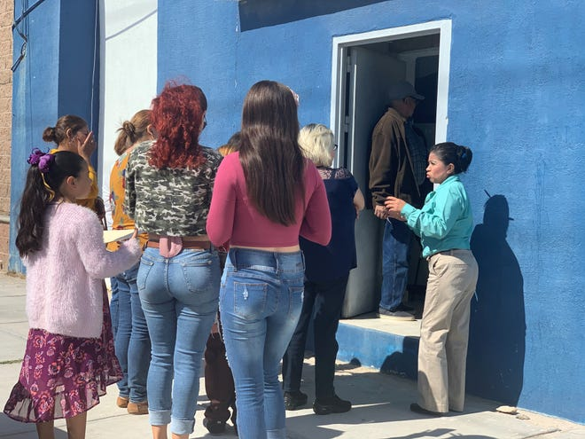 Families of missing relatives line up outside the public ministry in Puerto Peñasco, where lab workers are collecting DNA samples on Oct. 29, 2019. The work stems from the discovery of a mass grave east of the city the week before.