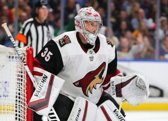 Coyotes goaltender Darcy Kuemper looks for the puck during the second period of a game against the Sabres.