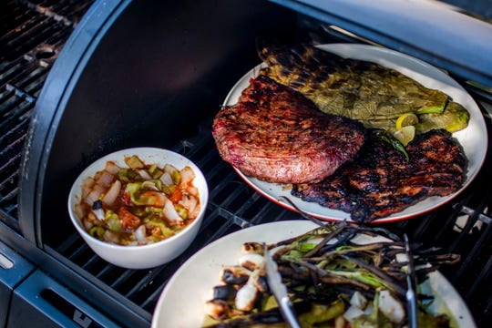 Carne asade, salsa, nopales and grilled vegetables sit ready to eat at Chef Rincon's home in Tempe on Thursday, Oct. 24, 2019.
