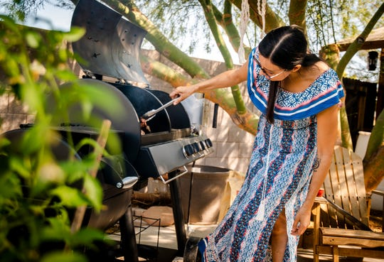 Chef Minerva Orduno Rincon grills carne asada at her home in Tempe on Thursday, Oct. 24, 2019.