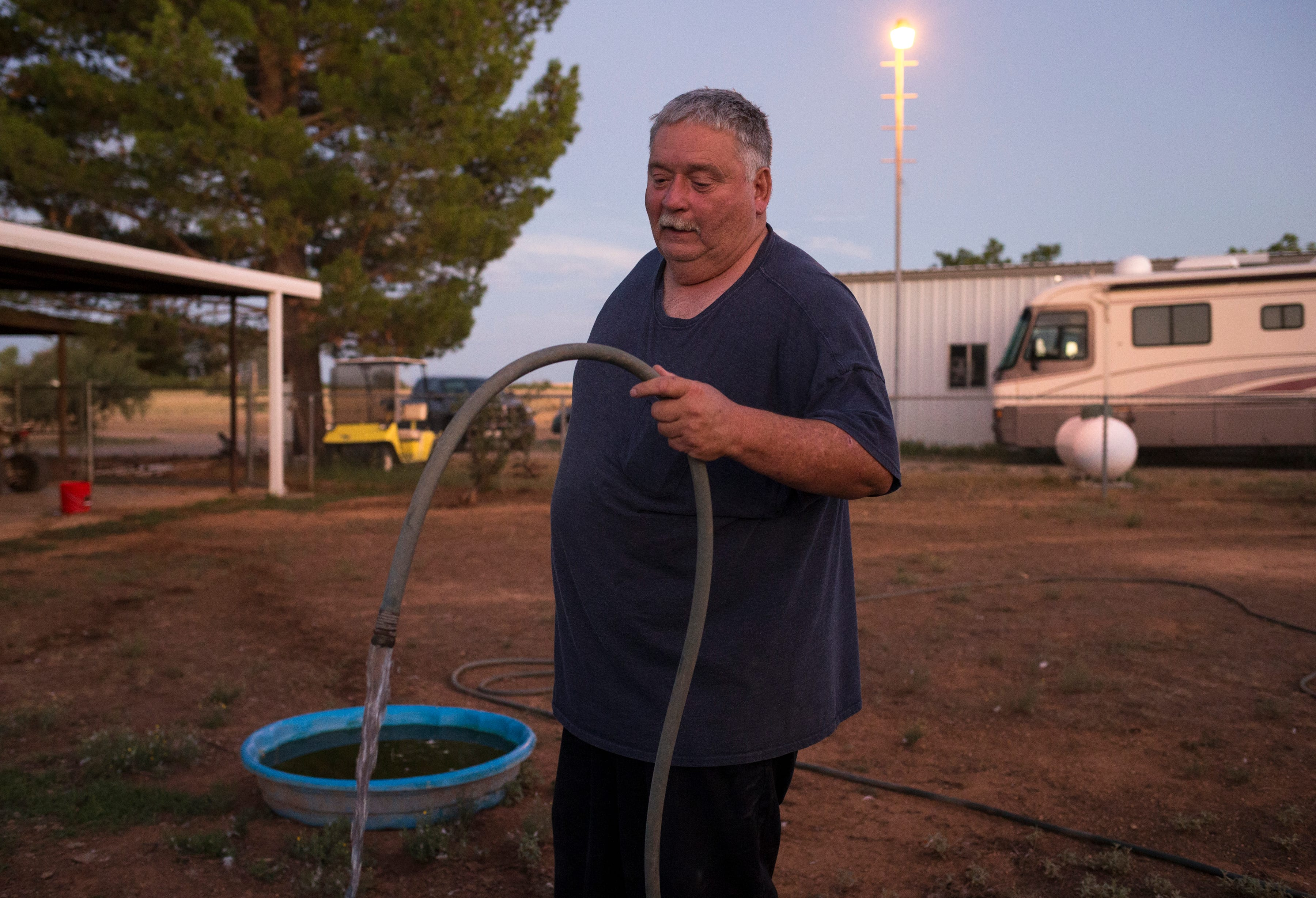 Richard Wilson waters his animals, August 13, 2019, at his home in Cochise, Arizona. Wilson's well went dry and he is now hauling water to his property.