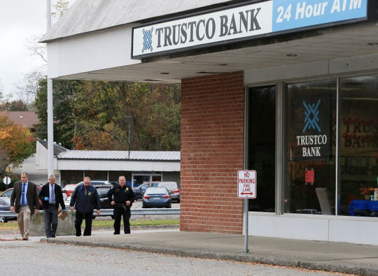 Town of Fishkill police search the property surrounding the Trustco Bank on Route 52 in Fishkill on October 29, 2019.  The bank was robbed on Tuesday.