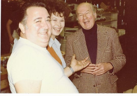 """Ralph and BJ Guidetti share a moment at the restaurant with Jack Denton Scott, co-author of """"The Great Potato Cookbook."""""""