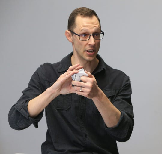 Derrin Berger performs a card trick while visiting the Poughkeepsie Journal offices on October 29, 2019.
