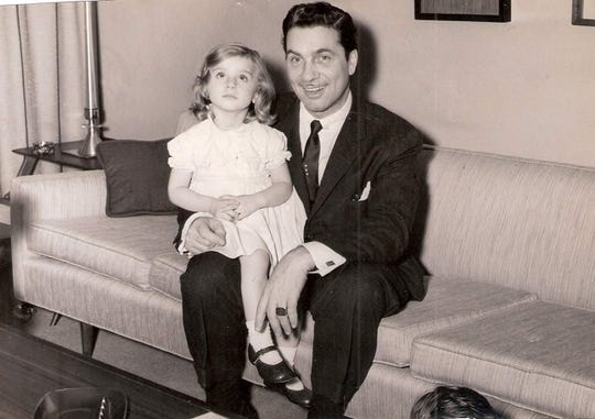 """Lisa Beni is shown with her father Nick Beni in the apartment over the restaurant at 2 Delafield St. in Poughkeepsie. The Benis adopted three children; Lisa was adopted in January 1959, born in Salsomaggiore Terme, a community in Parma, Italy, in the Emilia-Romagna region, at the foot of the Apennines. """"I was the same age as my brother John"""" who was born in Brooklyn in 1956 of Italian descent, she said."""