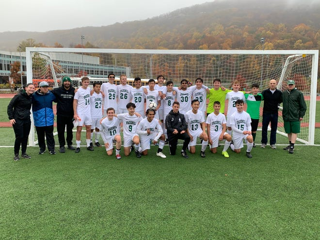The Spackenkill boys soccer team poses after pulling an upset of James I. O'Neill in a Section 9 Class B quarterfinal on Tuesday.