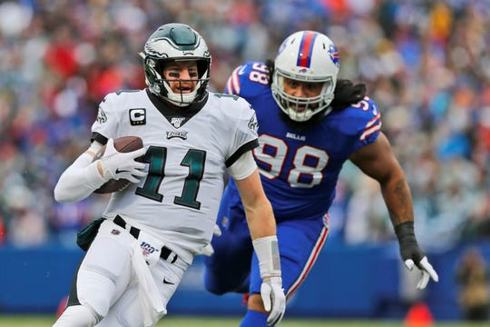 Philadelphia Eagles quarterback Carson Wentz runs the ball during the first half of an NFL football game against the Buffalo Bills, Sunday, Oct. 27, 2019, in Orchard Park, N.Y. (AP Photo/John Munson)