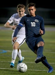 Dallastown's Gabe Wunderlich, right, moves the ball with Palmyra's Mitchell Dowling defending in a District 3 Class 4-A boys' soccer semifinal at Dallastown Tuesday, Oct. 29, 2019. Bill Kalina photo