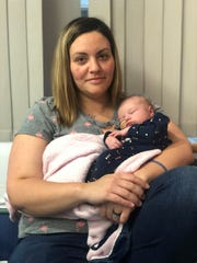 New mom Janessa Noll holds her 25-day-old baby, Emma Jeanne, at the Children's Hospital of Philadelphia, where Emma is being treated for acute myeloid leukemia.